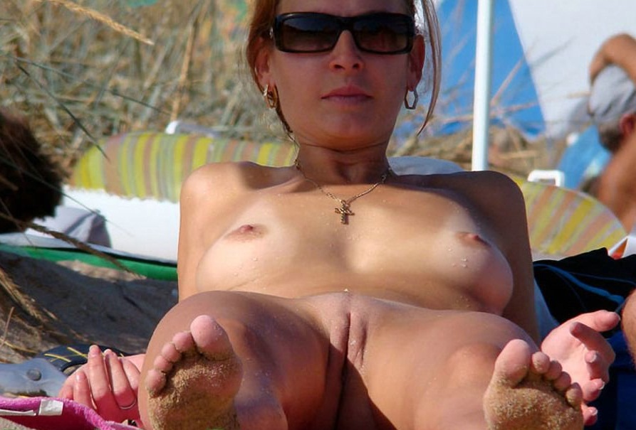 Awesome damsel at the nudist beach revealing her cute small pussy
