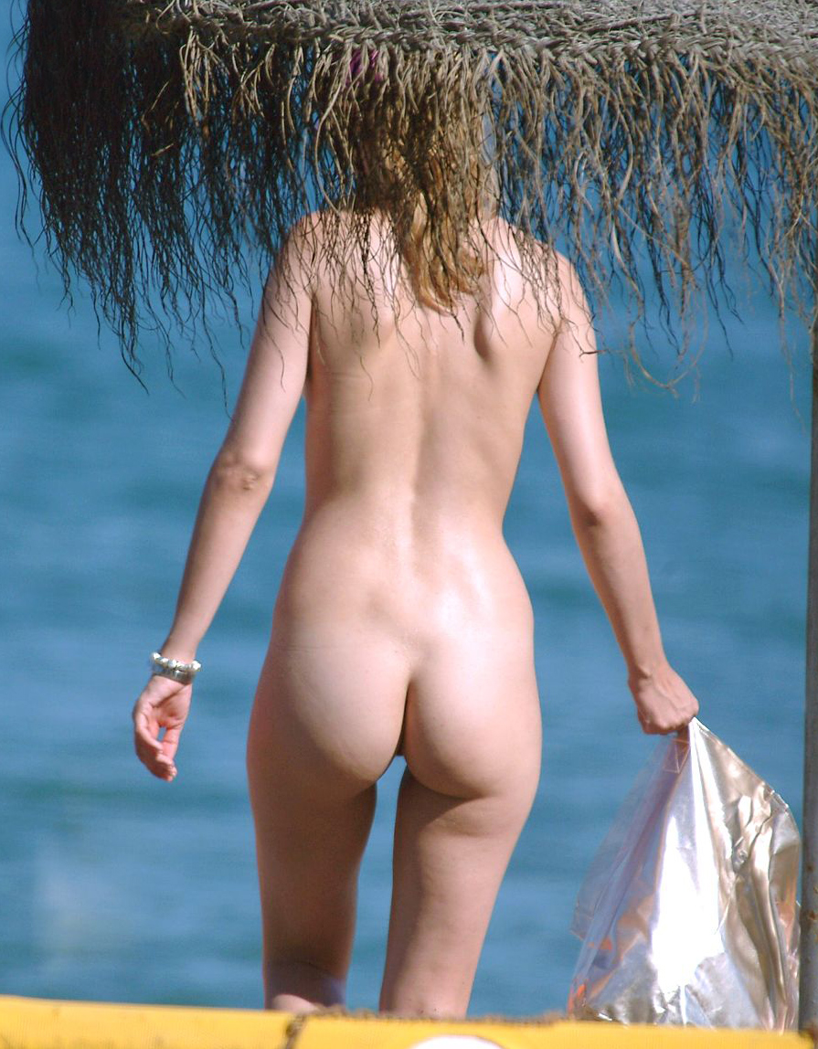Wild peisage with a hot nude lady walking to the water to embrace the warm ocean