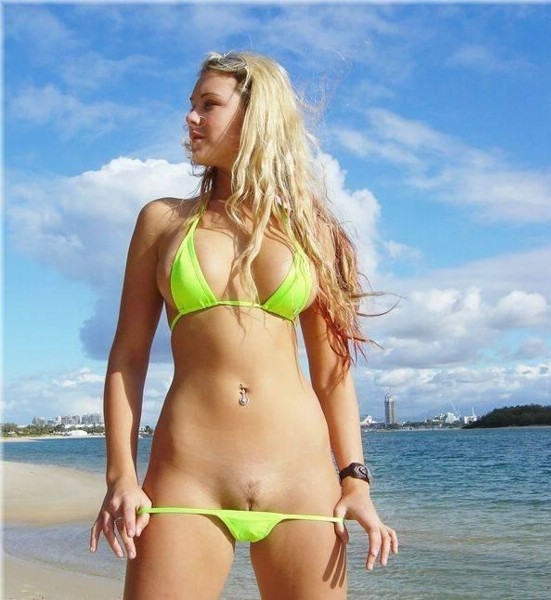 Gorgeous blonde takes off her bikini by the beach