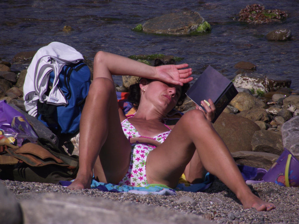 Reading a book while tanning