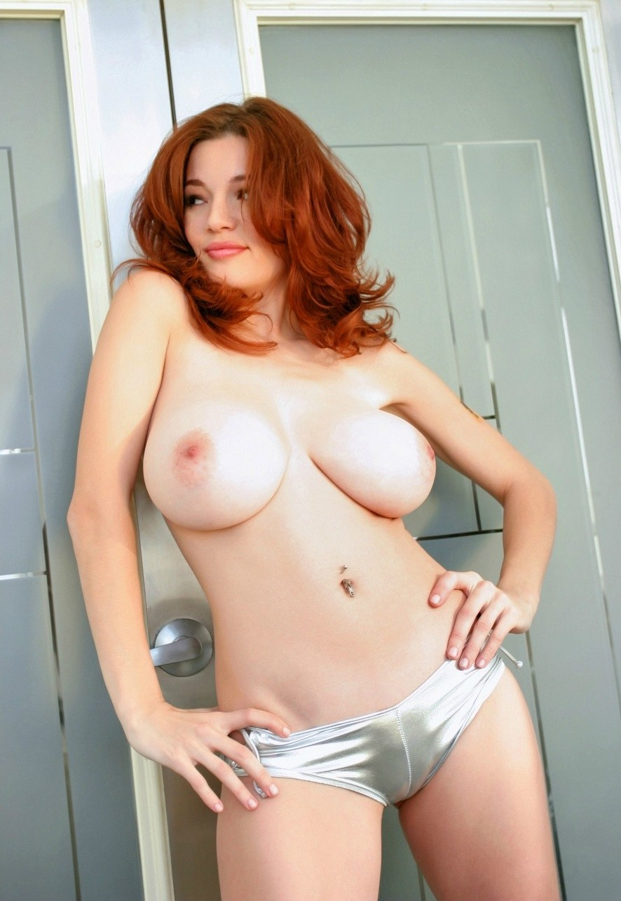 Redhead babe has awesome boobs