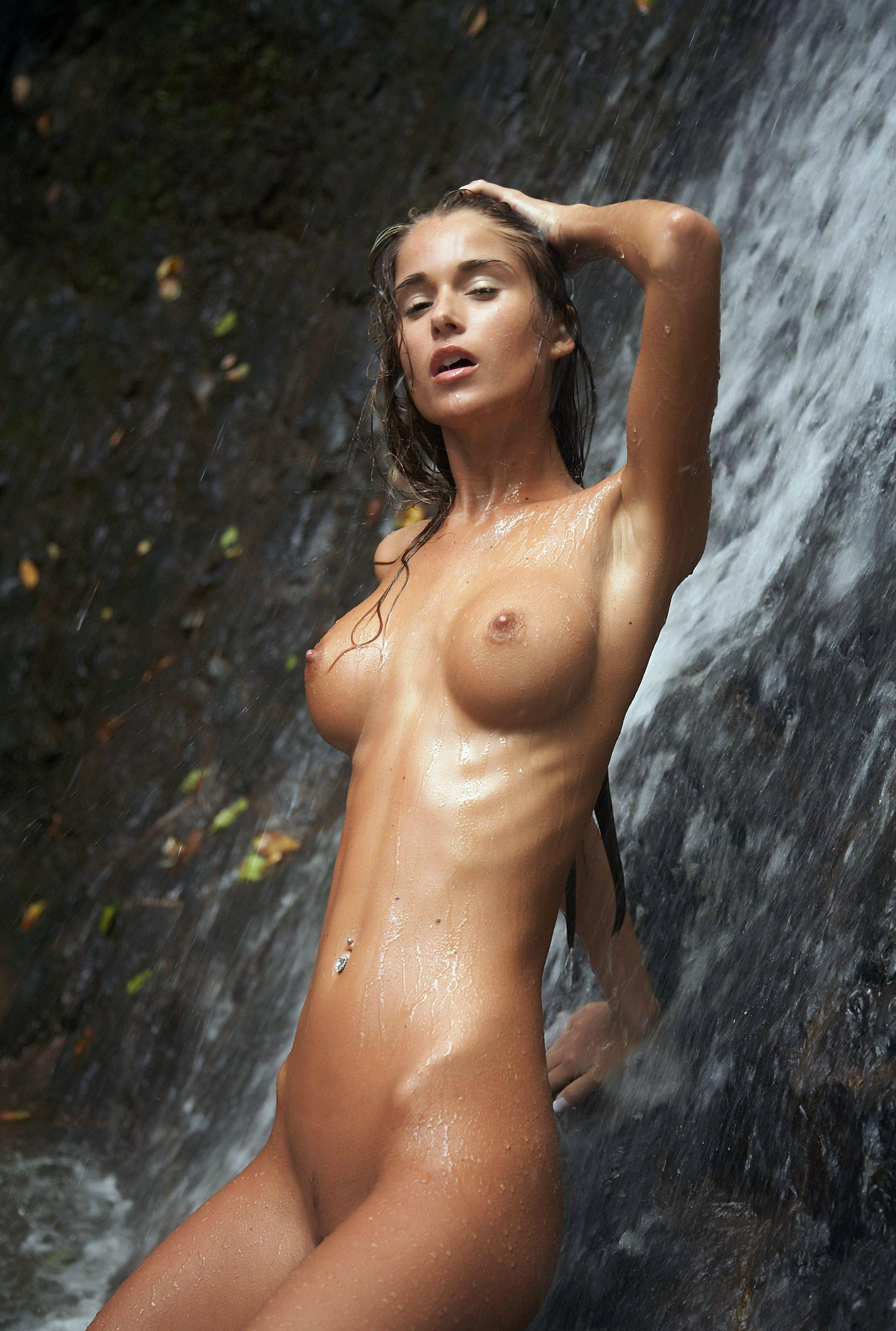 Damsel with gorgeous boobies under the waterfall