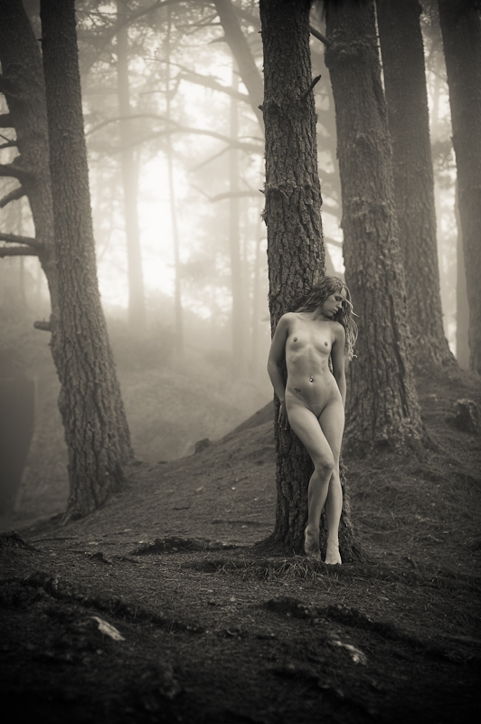 Naked angelic girl lost in forest