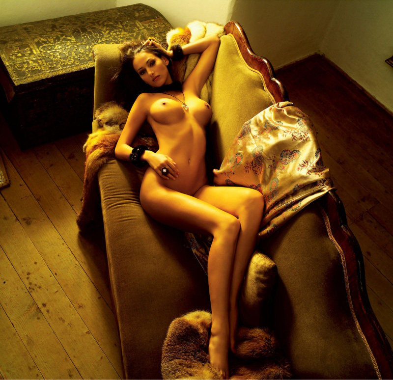 Awesome female laying naked on the couch