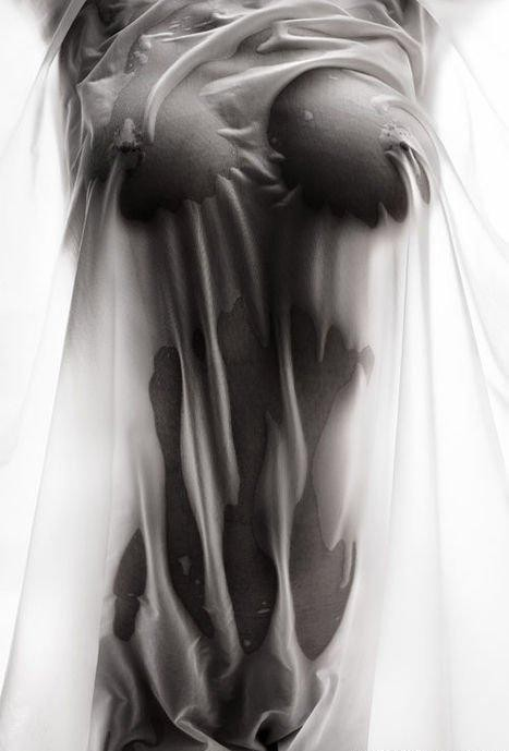 Artistic nude big wet boobs in a black and white picture