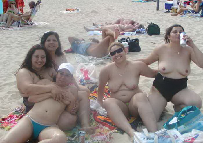 Fat females at the beach with huge bosoms having a beer