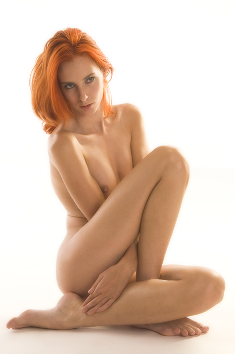 Naked redhead with long beautiful legs and awesome body in a yoga position