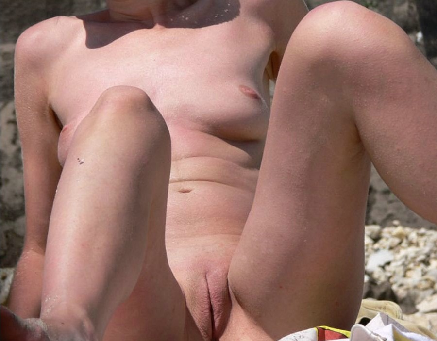 Beautiful mistress all naked while sunbathing with bald small snatch